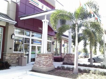 PBIA Travel Plaza Cell Phone Lot 7-Eleven entrance