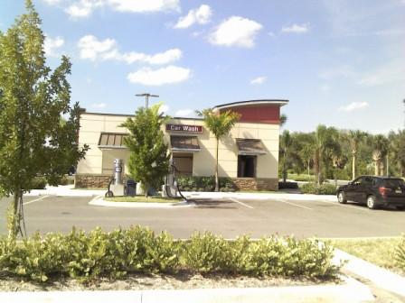 PBIA Travel Plaza Cell Phone Lot Car Wash
